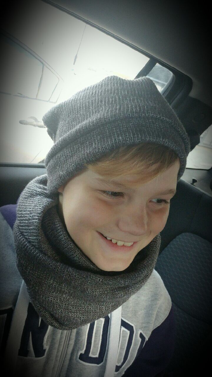 So stylish in this slouchy beanie and infinity scarf. Boys are loving these hats! #hatsforboys #beanies #slouchybeanie #Christmasgifts #stylishkids