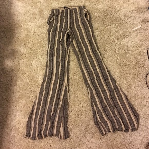 Stone cold fox flares! Worn once. Size 2 or 4 Flare high wasted stone cold fox. Stretchy at the waste so could fit 2 or 4! Stone Cold Fox Pants Boot Cut & Flare