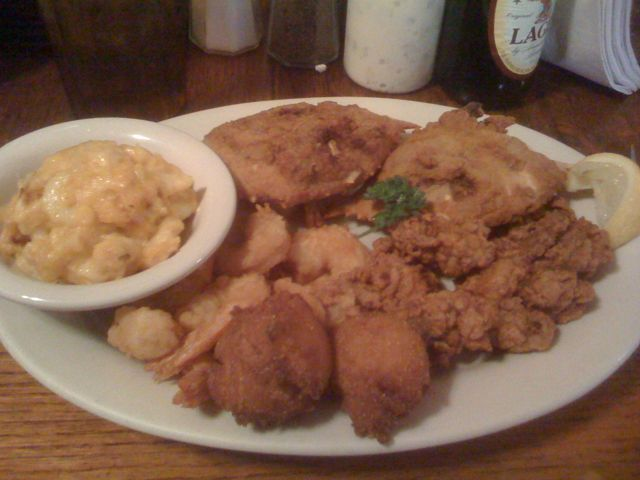 Fried Seafood Platter at Hyman's Seafood, Charleston SC....Mac n' Cheese, fried shrimp, deviled crab, fried oysters, and the best hush puppies ever.