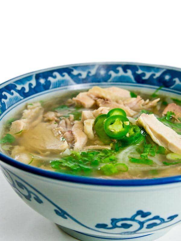 Recipe for Pho Ga, Vietnamese Chicken Noodle Soup. A light chicken broth with banh pho noodles and tender poached chicken.