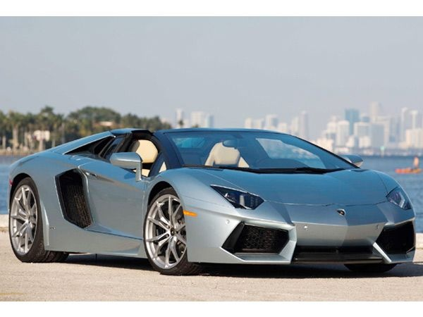 Lamborghini Aventador Roadster  Price: Rs 4.7 cr*  Maxing out at 350 km/h, this latest release by Lamborghini is one of the most sought-after cars and boasts of a 6.5l V12 engine.  Image Courtesy: Lamborghini