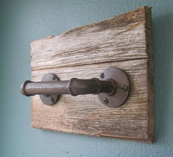 This rustic hand towel holder is handmade using salvaged barnwood, and an industrial style pipe as the handle. This piece makes a lovely addition to