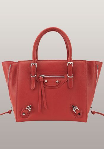 The Route 66 Leather Tote Red - Cowhide leather  Sliver tone hardware Zip top closure Fabric interior lining  The zipped sides expand to create extra room when needed  Carry it by two top handle or the optional shoulder strap