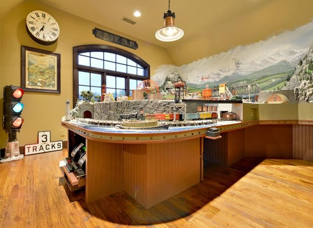 Model train room... nicely finished to showcase the art.