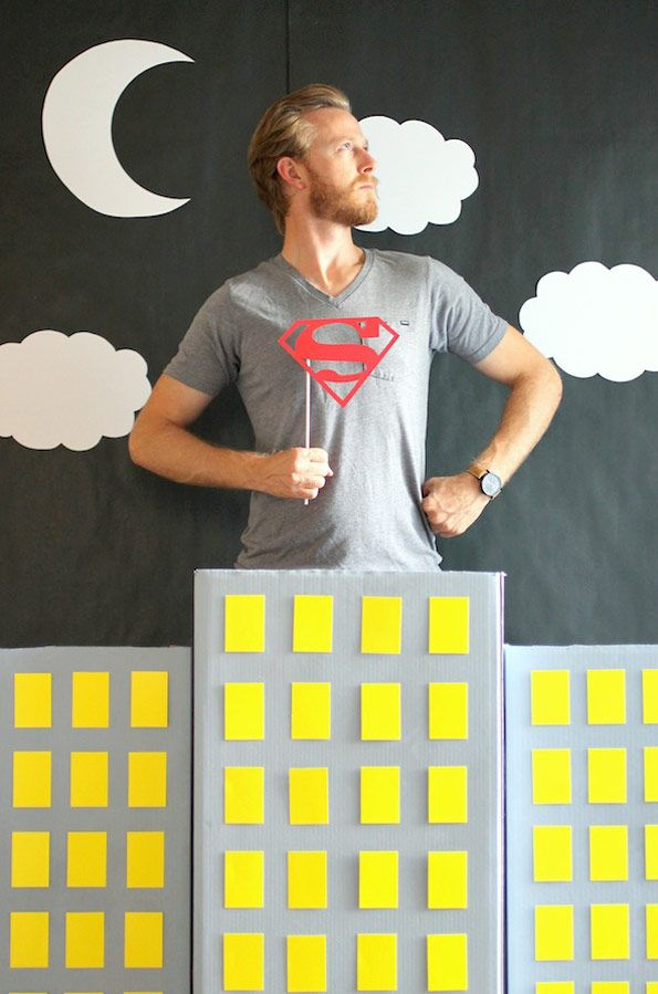"""comic book party: We found our superhero props on Etsy and mixed them with """"Happy Birthday"""" signs printed using this free comic book font. You can also scour thrift shops for superhero Halloween costumes and masks to use as props."""