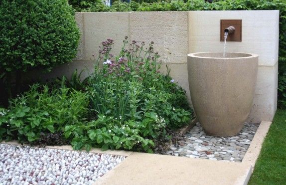 Water feature wall mounted spout into a container arne - Wall mounted water feature ...
