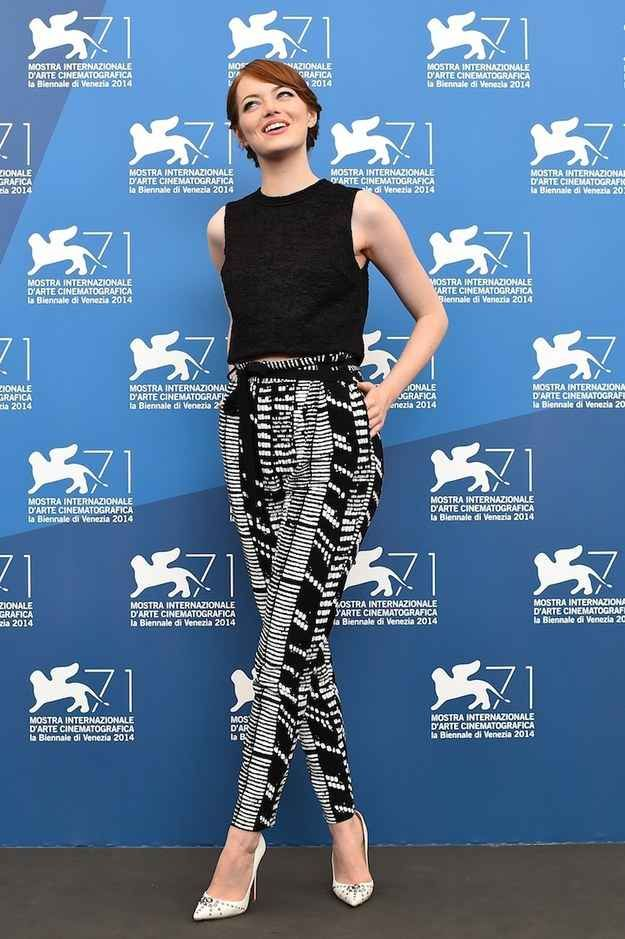 Emma Stone   black sleeveless crop top + patterned black and white high waisted pants + white pointed toe studded heels