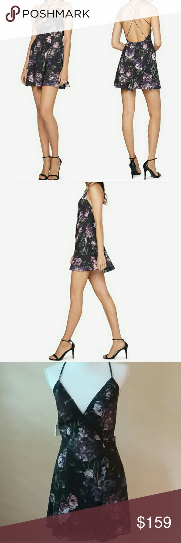 """🆕Fame and Partners Floral Neckline Gown A metal-tipped necktie echoes the delicate crisscrossing straps of this v-neckline mini dress, styled in a floral pattern with a fit-and-flare silhouette for movement. Hidden zipper with hook-and-eye closure.  Multiple spaghetti straps with open back.? Necklace tie.Fit-and-flare silhouette. Lined. Hits above knee. Approximate measurements: 18"""" skirt length, 28"""" waist.? Material:shell and lining: polyester heavy georgette; trim: nylon. Fame and…"""