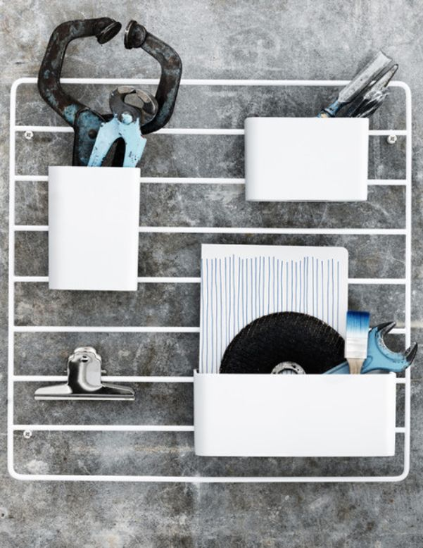 The String Works Grid Wall Organiser is the latest addition to the String shelving storage system. Three storage pockets hang from a wall mounted metal grid – perfect for the well-organised home or office.