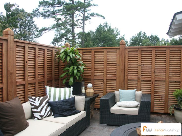 Another Angle Of A Beautiful Custom Wood Privacy Fence Design From Inside A  Backyard Patio.