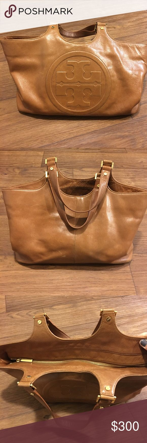 Tory Butch Bombe leather handbag w/duster! Used Tory Butch Tan Bombe leather handbag w/duster! I actually can't really believe I am listing this bag, it's my most favorite bag I have ever owned! It is in really good condition. This is a fabulous leather handbag, one that every woman should own! No trades, sorry. Tory Burch Bags Satchels