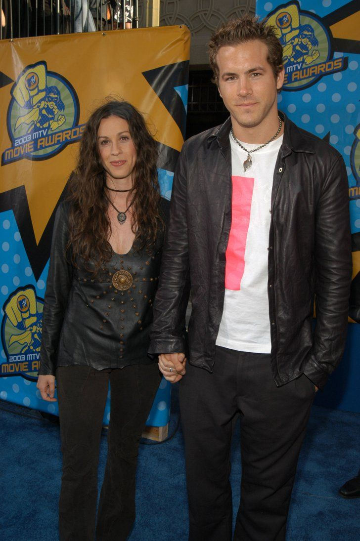 Pin for Later: Two of a Kind: Matchy-Matchy Celebrity Couples Ryan Reynolds and Alanis Morissette For the 2003 MTV Movie Awards, Ryan Reynolds and Alanis Morissette wore leather on top with similar necklaces.