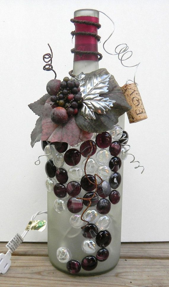 Best 25 decorated wine bottles ideas on pinterest for What to make with old wine bottles