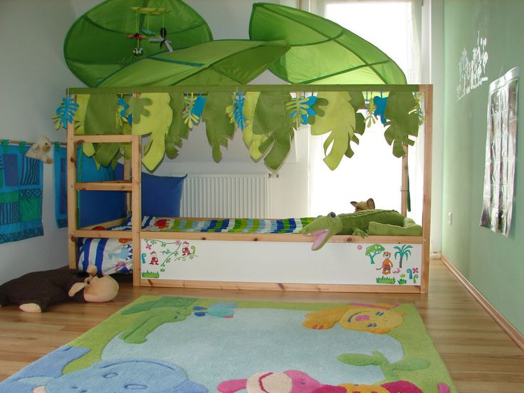 My favorite design... Jungle theme.  I will also use the giant Ikea leaves but I would paint the bed first as a more complete look.
