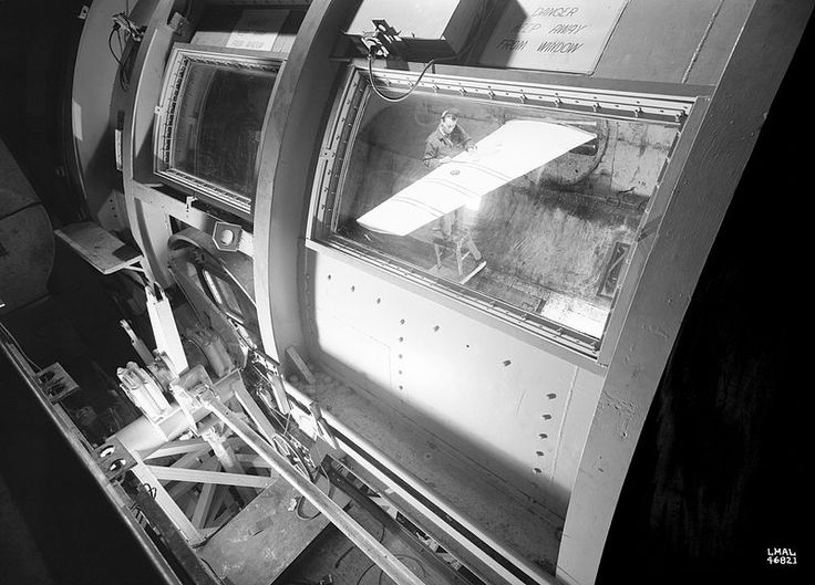 Test section of a wind tunnel at Langley as seen through a window from outside, 22 January 1946, public domain via Wikimedia Commons.