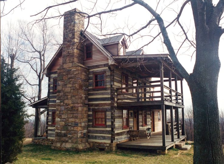 Great example of a three story traditional log cab…