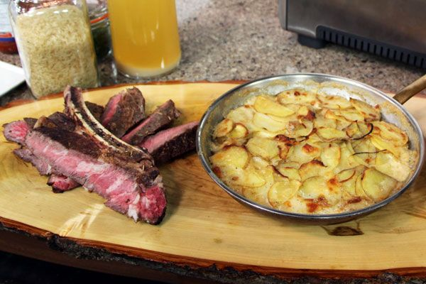 Rib steak with scalloped potato & mint cucumber salad