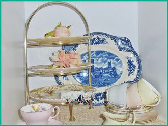 Vintage silver rod 3 tiered stand with assortment of vintage china plates for hire from Highteahire.co.nz Napier NZ An assortment of platters too.