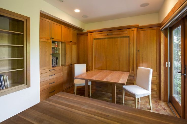SW Hills Mediterranean. Murphy bed doubles as a table. Flanked by storage units/bookshelves