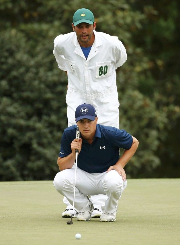 Jordan Spieth and his caddie, Michael Greller, look over a putt on the 14th green on Sunday.