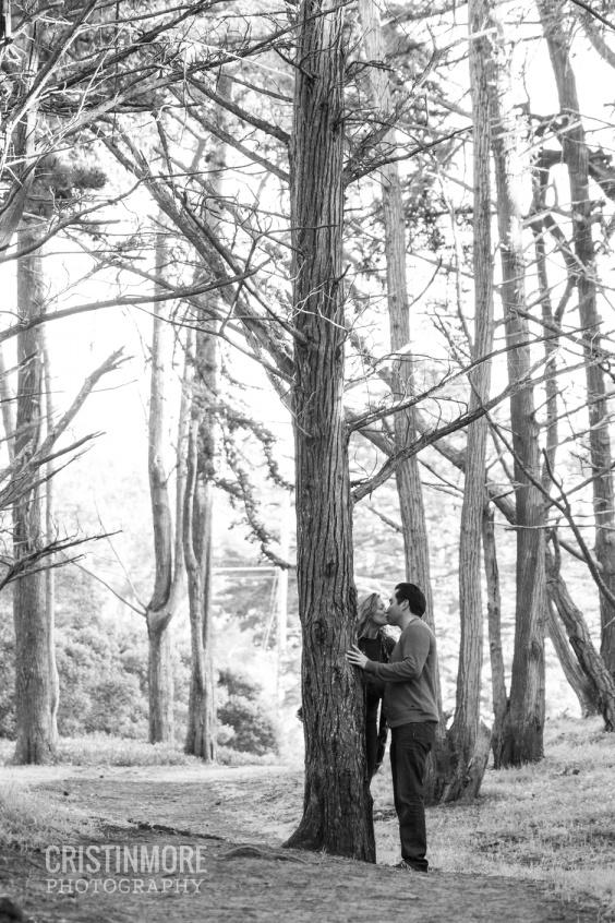 San Francisco Presidio Engagement Shoot- Couple kissing behind a tree