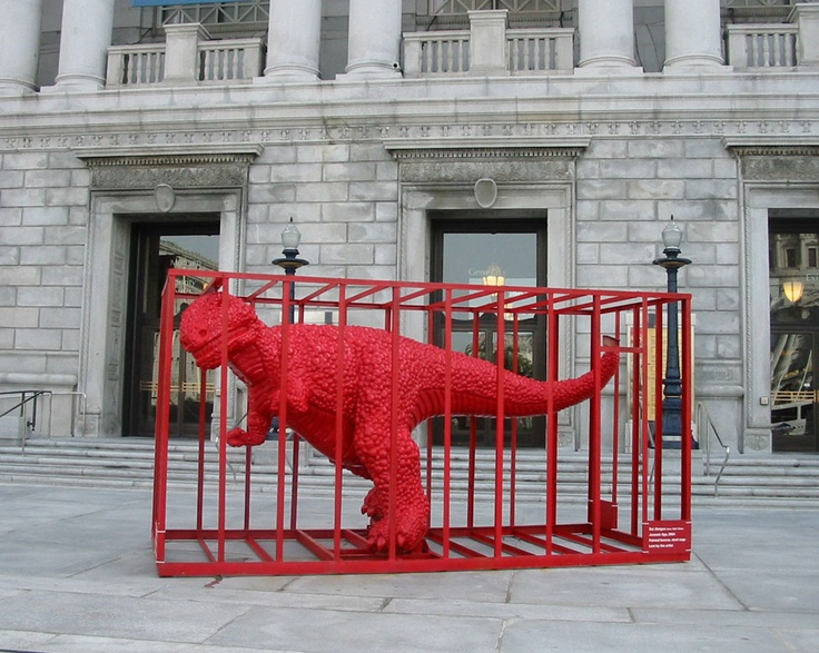 Sui Jianguo's red dinosaur in a cage