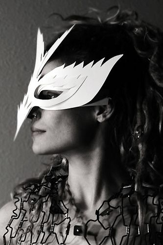 Would better with a real bird resting on her face as a mask