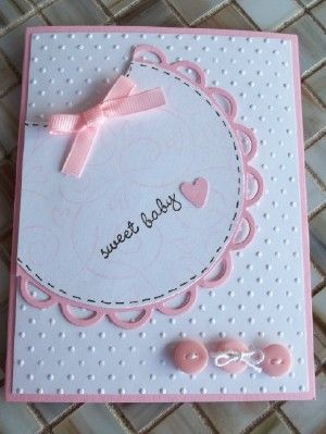 This baby bib is a modified circle with a cute doily edge. Add some buttons and bows for this DIY baby card.
