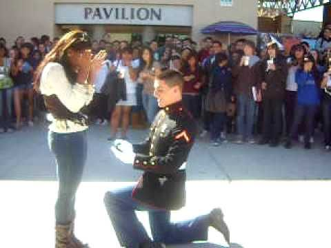 A Marine proposes to his girlfriend  she says yes! The hero always gets the girl in the end:) Love it