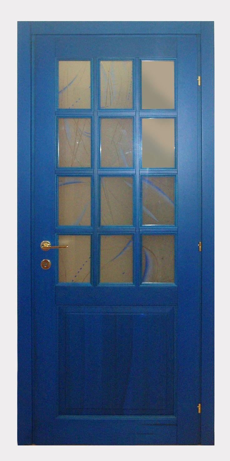 Porta in legno massello Toulipier, due bugne, mezza inglesina (dodici vetri nella bugna superiore), colore verde, blu e noce. porte Piacenza Lodi