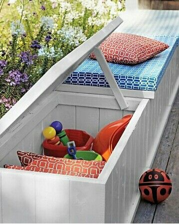 Wooden Storage Boxes as Bench with Great Space...(for the Pillows, Magazines, Toys)...Mattresses with a Merry Print Cover for a Soft Seat and Eyecandy Touch :-)
