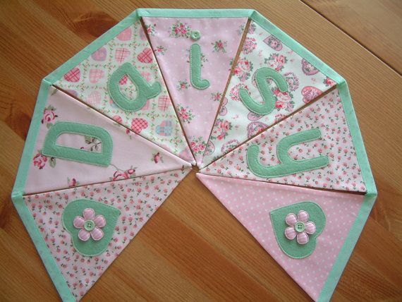 Personalised banner, name bunting. Pink & green. Baby girl. Bespoke. Fabric flags. Florals, rosebuds, dots. Applique hearts. Made to order.. £2.00, via Etsy.