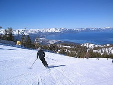 Alpine skiing is the sport of sliding down snow-covered hills on skis with fixed-heel bindings. It is also commonly known as downhill skiing