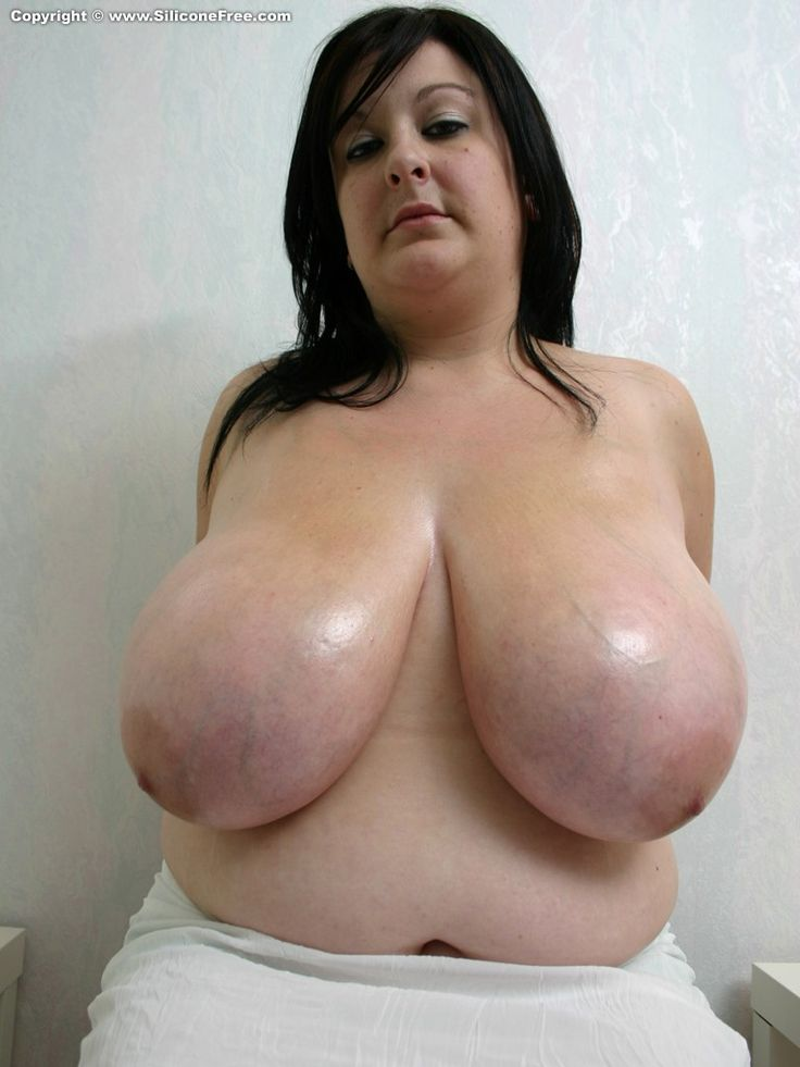 Mature oiled breasts