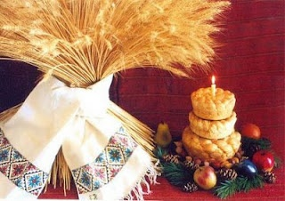 Ukrainian Christmas tradition. The three loaves represent the 3 kings, the candle is the star.  The large grouping of wheat that is put in the window for visitors to know they are welcome
