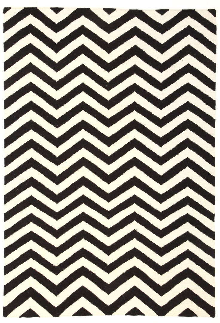 Miss Amara Cairo chevron rug  For some reason chevron rugs keep making us think of Egypt! It must be the geometric pattern. This black and white one is so striking! Hand knotted on a horizontal loom by skilled artisans in India, Cairo is a double-sided reversible chevron rug
