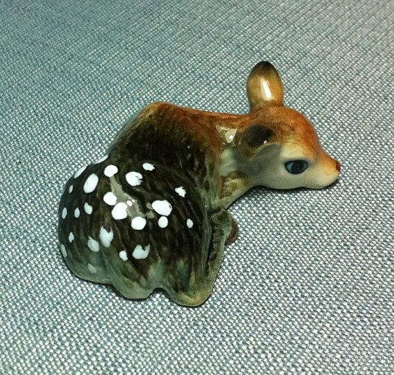 This cute miniature fawn was hand painted. It is very realistic.  This figurine is not vintage and not signed but it will be a perfect gift for fawns collectors and ceramic animals amateurs.   Dimensions:  Height: 1,5 cm / 0.6 Length: 4,3 cm / 1.7  Width: 3,3 cm / 1.3   Payment:  I accept only Paypal payment.   Shipment:  This figurine will be packed in a little carton box with bull paper inside to protect it. Then it will be shipped via Thai Airmail. Delivery time is from 2 to...