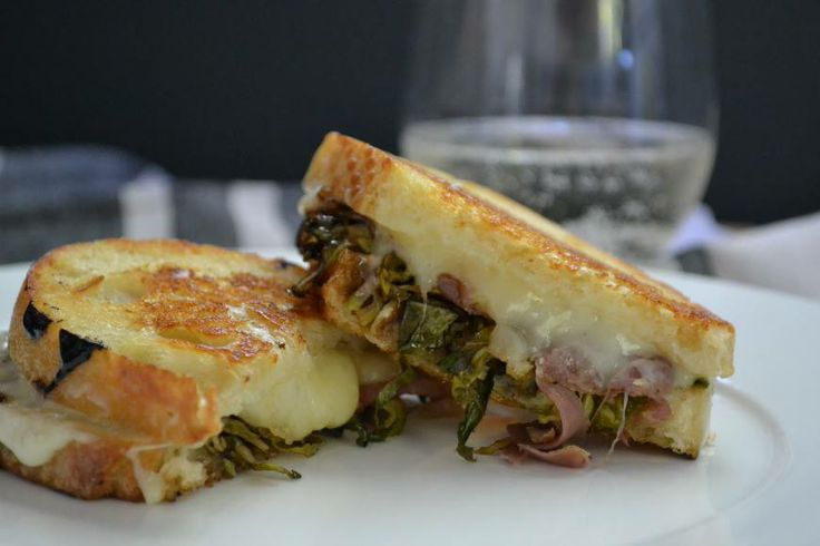 Balsamic roasted Brussels Sprouts, salty prosciutto, and gooey Fontina make an amazing grilled cheese sandwich! http://foodieheart.com/balsamic-roasted-brussels-sprouts-grilled-cheese/ <- recipe  if you have picky eaters here is good way to sneak it in without them realizing it  you can sub Bacon for the prosciutto and use a good Munster Cheese instead of fontina cheese