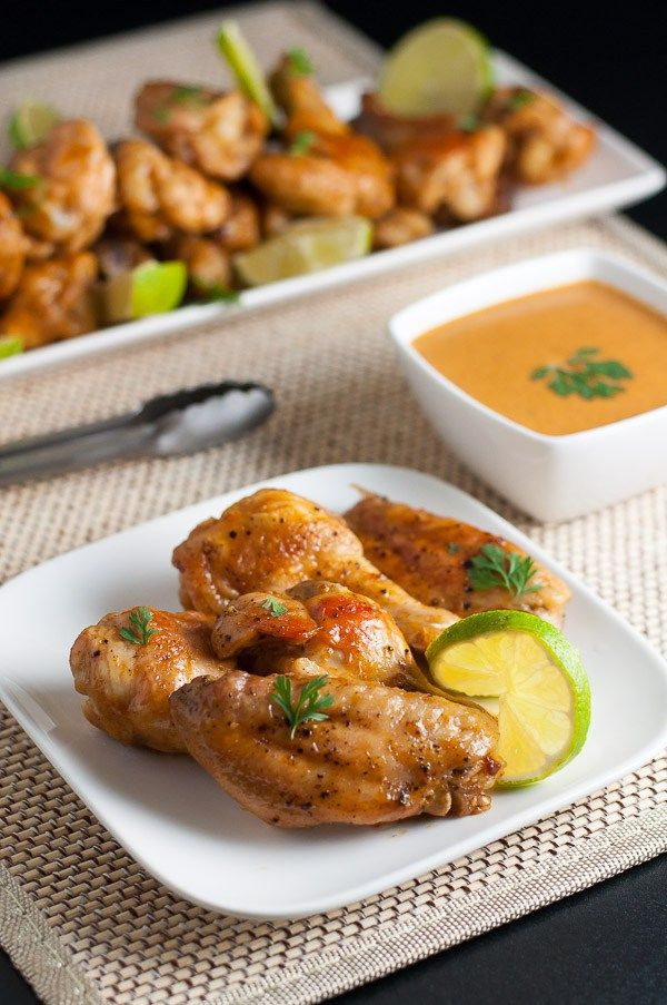 How to Make Spicy Thai Wings--HOW TO MAKE SPICY THAI WINGS 2015-10-29 by Flavour & Savour 2 Comments  Enjoy all the complex flavours of Thai food and learn how to make spicy Thai wings. Sriracha hot sauce, garlic and ginger, coconut milk and lime on crispy chicken wings make this a popular appetizer or snack.