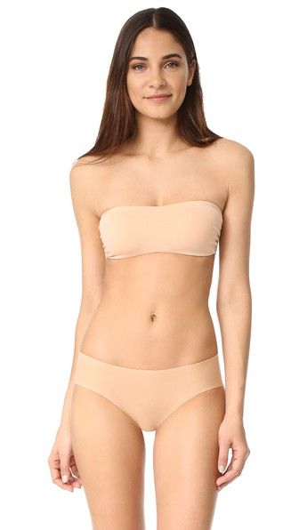 Get this Cosabella's strapless and multi-way bra now! Click for more details. Worldwide shipping. Cosabella Dolce Bandeau Bra: A jersey front panel pairs with a mesh back panel on this strapless Cosabella bralette. Boning structures the sides. Sheer back. 50% cotton/28% polyamide/12% elastane/10% viscose. Hand wash. Made in Italy. Bottoms sold separately. (sujetador sin tirantes y multiescote, bandeau, strapless, multiway, bh ohne träger und mehrfach ausschnitt, bh ohne träger und mehrfach…