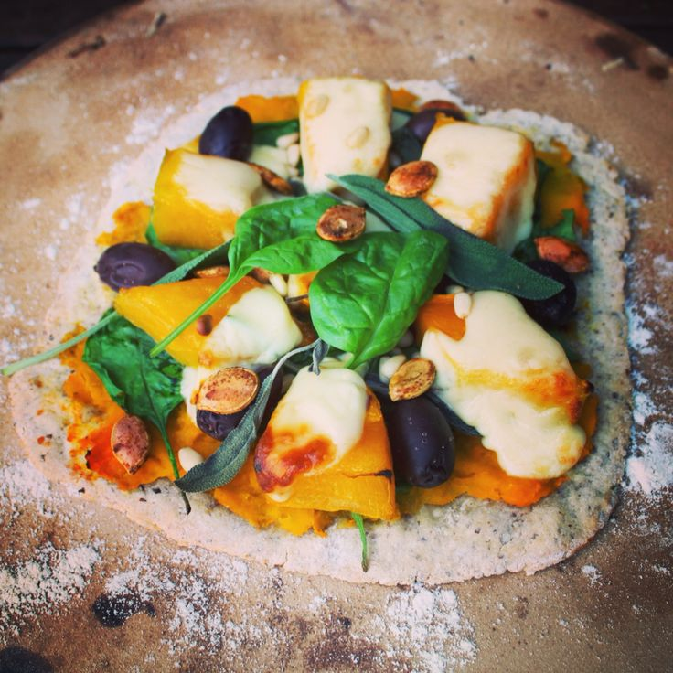 Pumpkin, sage and mozzarella pizza. Roasted pumpkin seeds with cumin ...