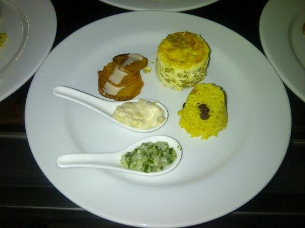 south african main course bobotie, pumpkin fritters with amarula sauce, cucumber and banana sambal and yellow rice