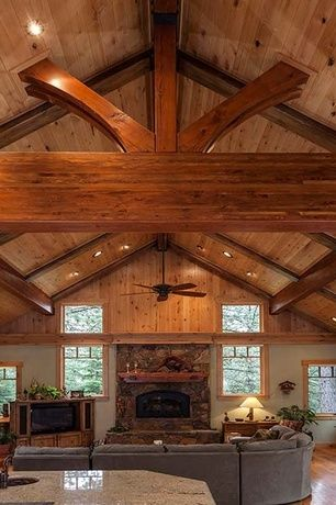 Cathedral ceilings rustic living rooms and exposed beams for Half vaulted ceiling with beams