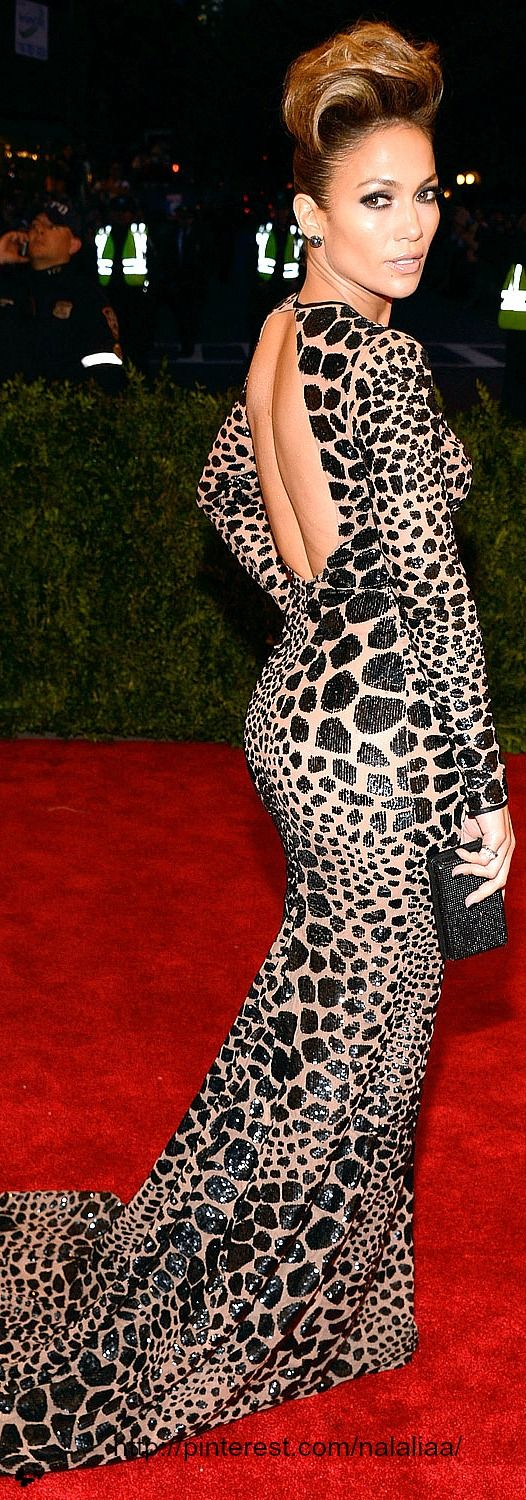 She Is Fab!! Met GALA 2013:    Jennifer Lopez The dress: Michael Kors custom black leopard sequin-embroidered gown with long sleeves and open back  The bling: Dana Rebecca Designs earrings and a Rona Pfeiffer ring.