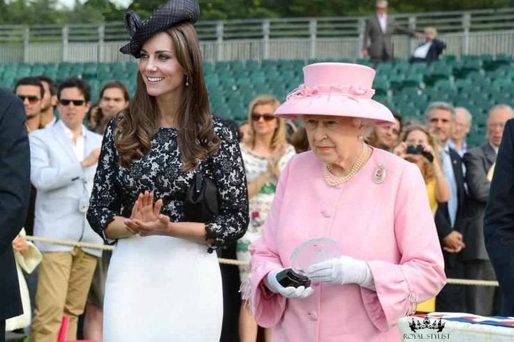 Elegant PoloHer Majesty the Queen invited the Duchess of Cambridge to attend an engagement with her. The Queen was asked to present the award to the winner at the GCC Polo Cup, and requested that the Duchess assist her. The Duchess is wearing a white form-fitting dress with black lace overlay and 3/4 length sleeves. She wore her Links of London earrings and an oversized black Lock & Co. hat . Too funny
