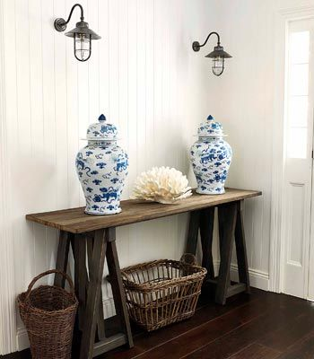 These blue and white Ginger Jars on this rustic saw horse table remind me of an entryway in a Nantucket home...