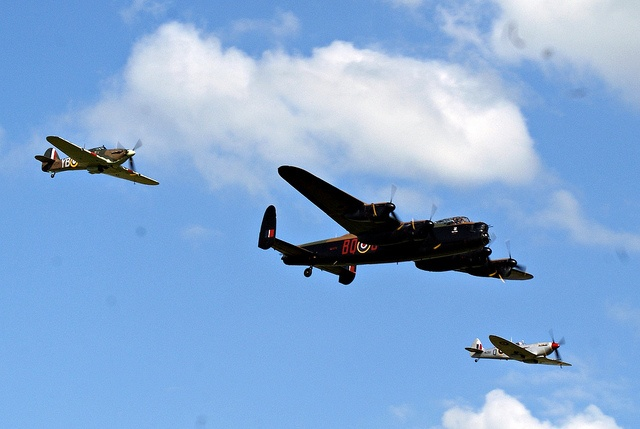 Battle of Britain Memorial Flight  by P.A.King, via Flickr  -- a Hurricane, Lancaster, and Spitfire...but I'm not sure which is the Hurricane and which the Spitfire; they're hard for me to tell apart.Britain Memories, They R Hard, Spitfire But I M, Memories Flight, Theyre Hard