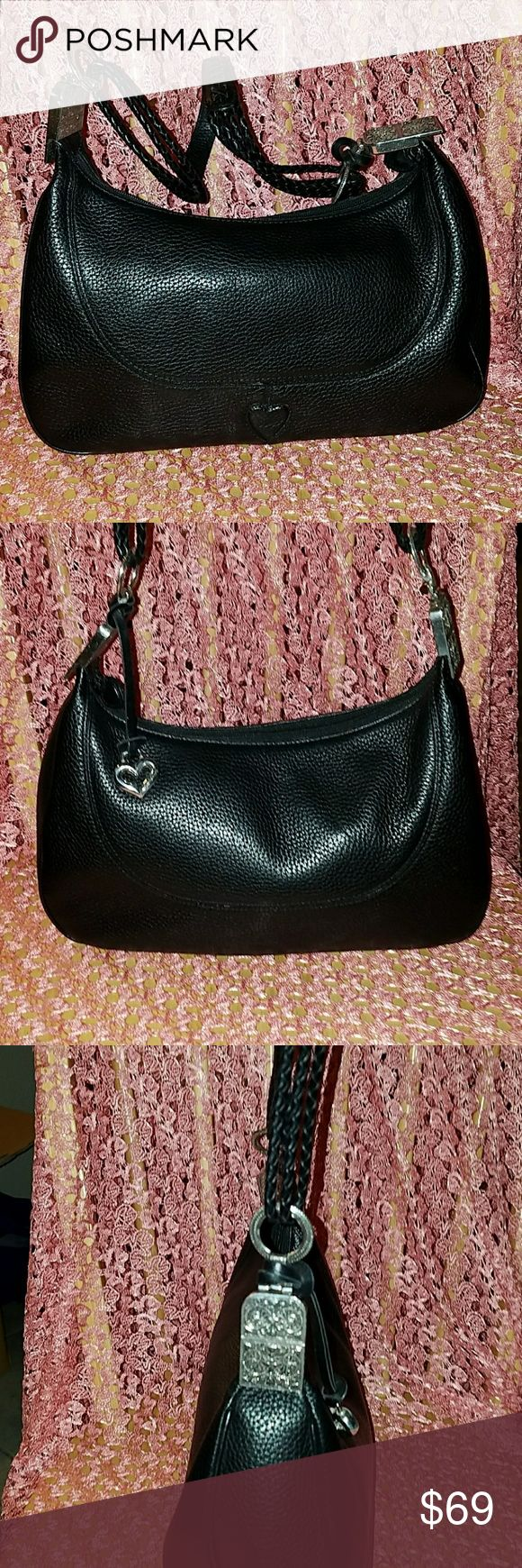 Brighton black pebbled leather bag Beautiful detailed black pebbled leather bag, Brighton heart fob,braided leather straps, silver hardware no tarnish,no wear on bag,red lining Brighton Bags Shoulder Bags