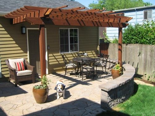 wolfsmith residence the extended patio pergola and seat wall create a cozy outdoor dining - Extended Patio Ideas