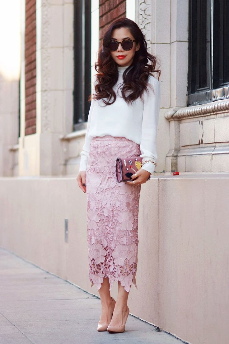 Shop this look on Lookastic:  http://lookastic.com/women/looks/pink-midi-skirt-pink-clutch-tan-pumps-white-long-sleeve-blouse/1056  — Pink Lace Midi Skirt  — Pink Leather Clutch  — Tan Leather Pumps  — White Long Sleeve Blouse